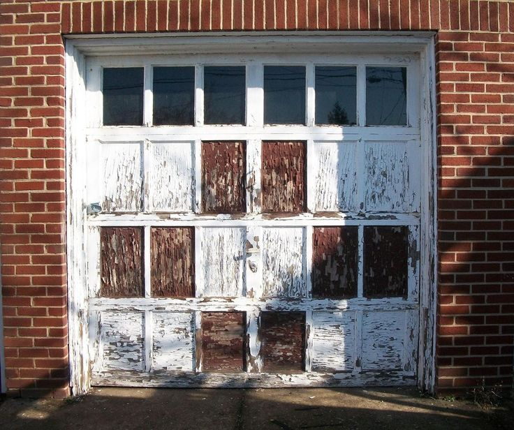 Would You Replace This Garage Door Or Would You Embrace The Vintage Style Garage Door Spring Repair Garage Doors Garage Door Springs