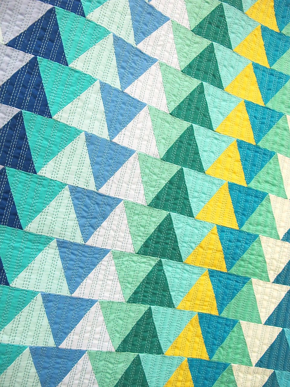 Nestled Together by AnnMarie Cowley, adaptation of a quilt by Joyce Dean Gieszler