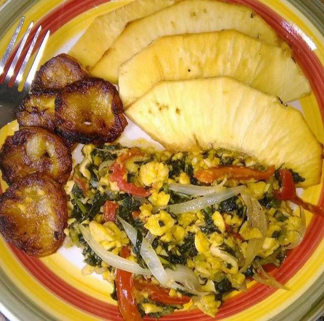 Roast breadfruit and ackee garnished with sweet fried for Afro caribbean cuisine