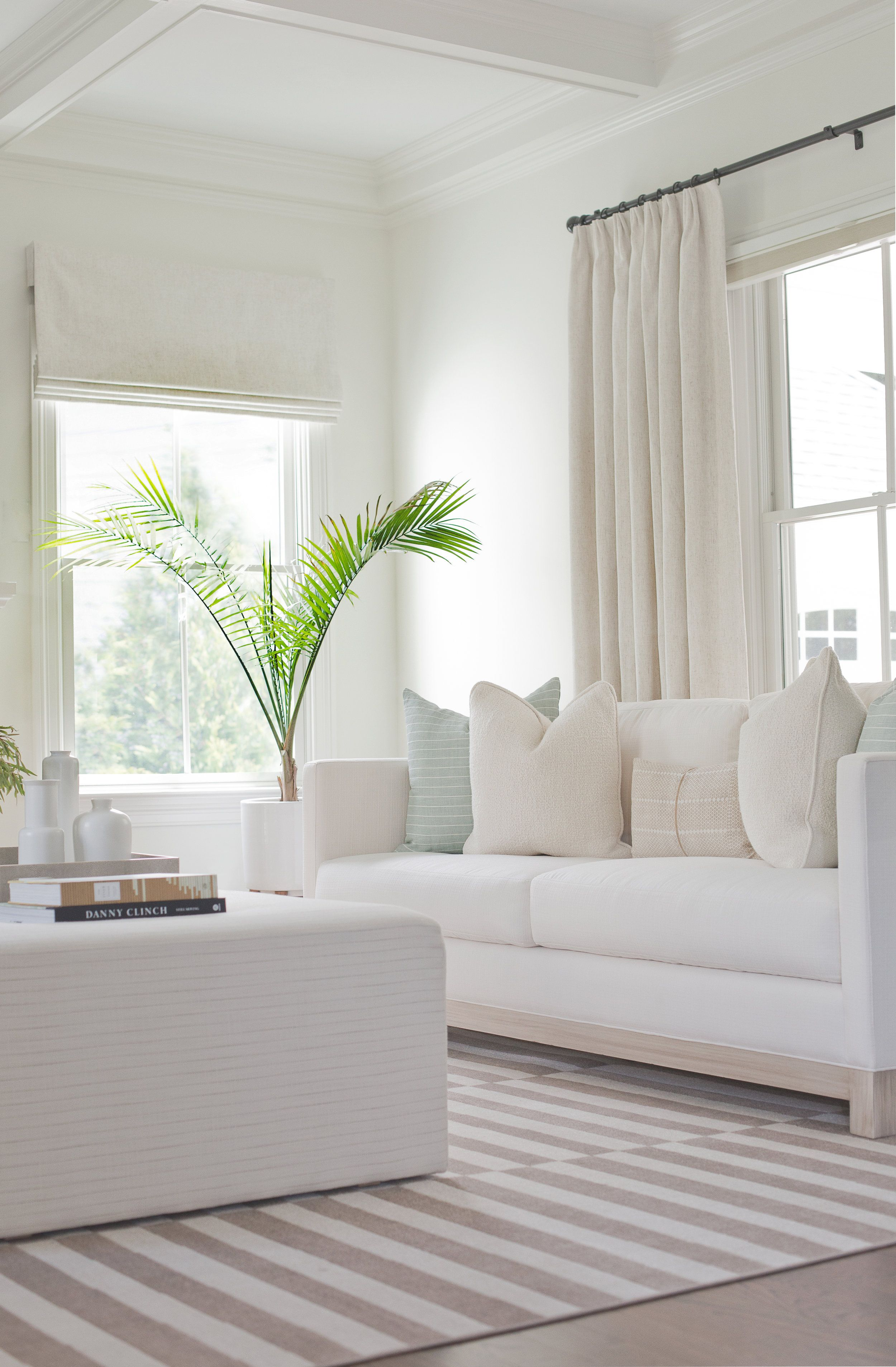 Light And Bright Living Room White Sofas Striped Area Rug White Coffered Ceiling In The Living Room Kara White Sofa Living Room Home Bright Living Room