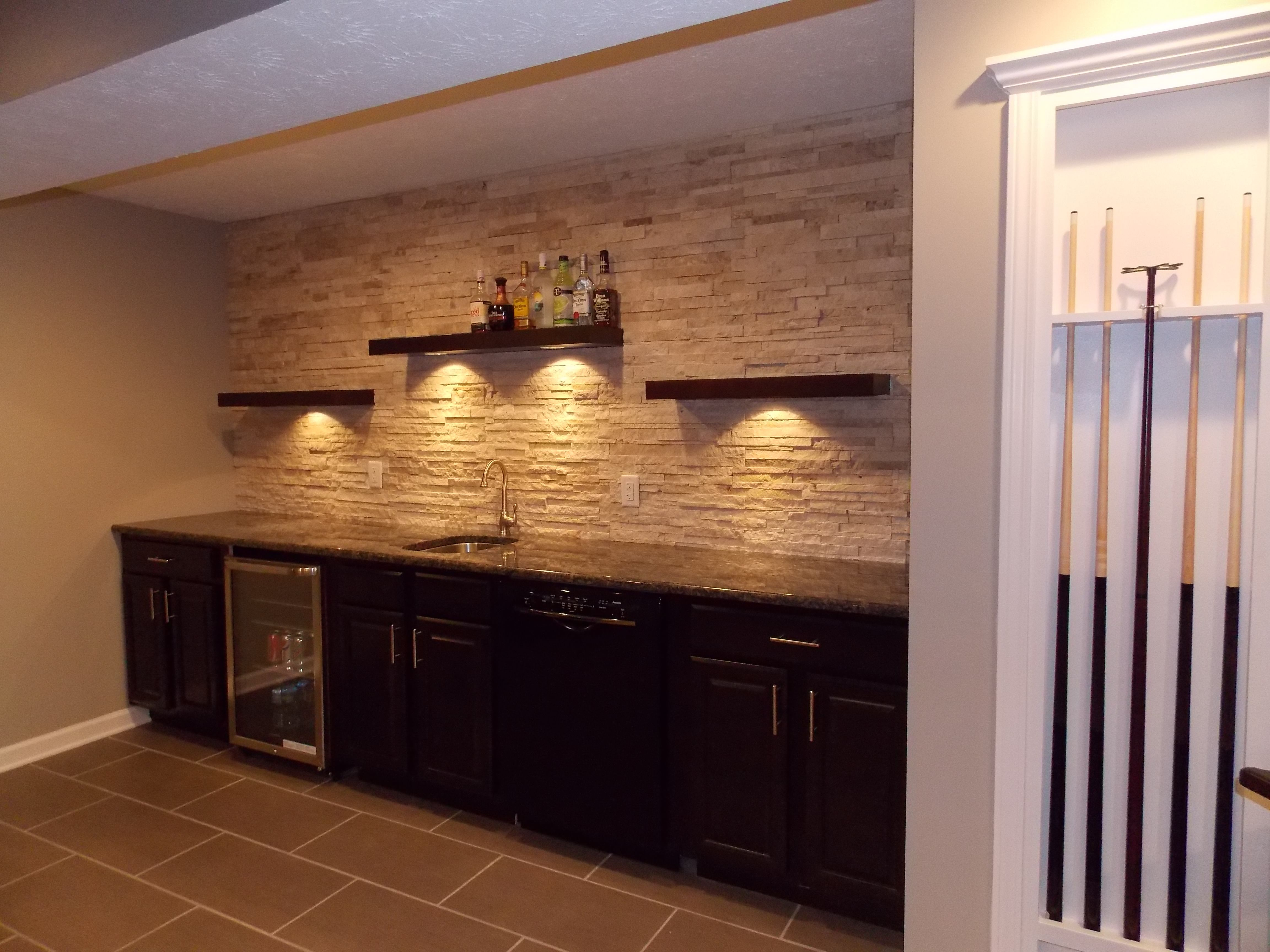 Cmh Builders Wet Bar With Floating Shelves On Stacked Stone Wall Wet Bar Basement Basement Bar Designs Basement Bar Plans