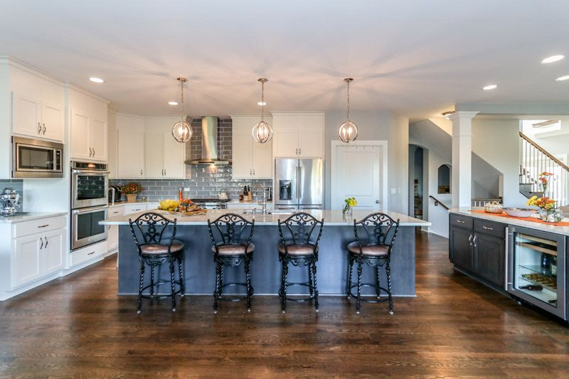 Custom twotone gourmet kitchen in Modified Logan floor plan by DJK – House Plans With Gourmet Kitchens