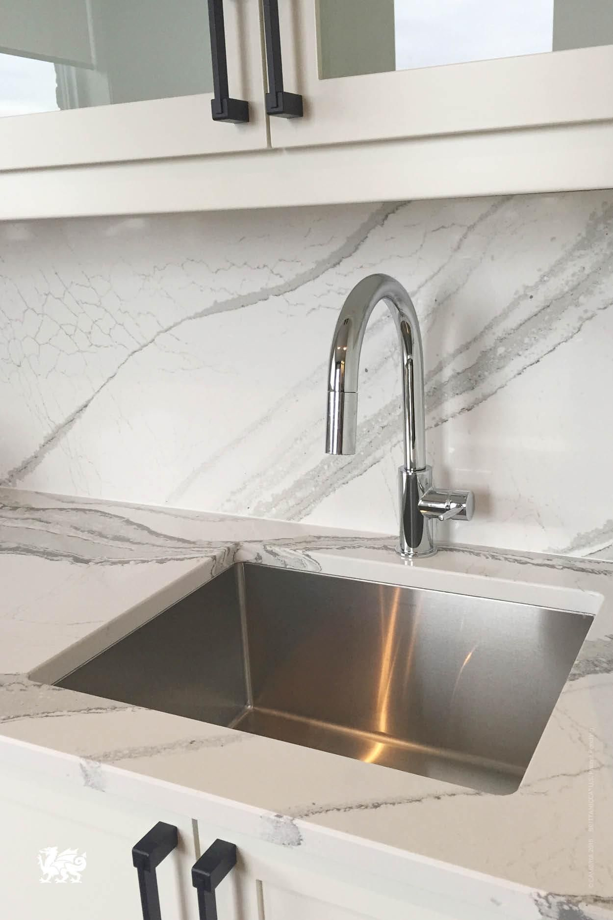 This wet bar defines seamless beauty with our brittanicca for Seamless quartz countertops