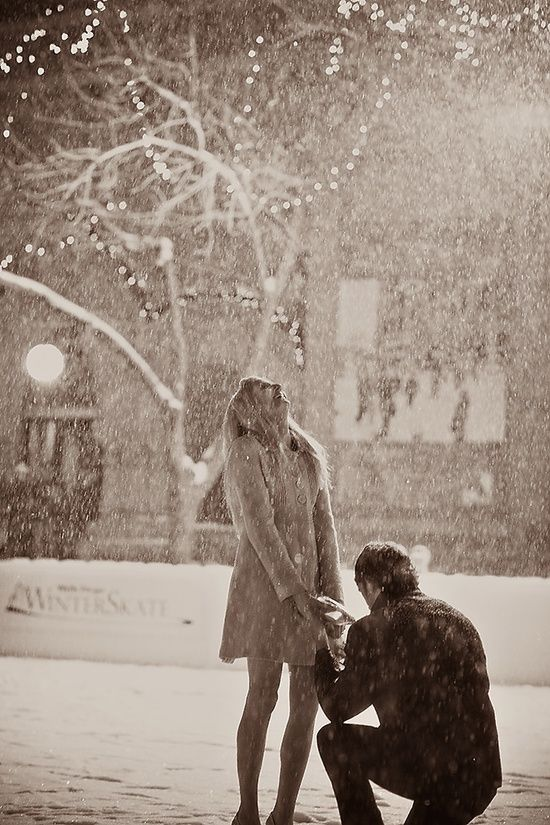 Falling snow makes a perfect engagement