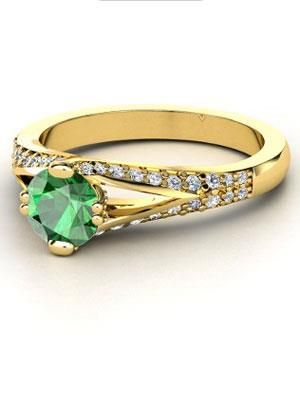 Jacqueline Kennedy: Emerald Ring Always a trendsetter, Jackie, with her emerald engagement ring surrounded by 2.88 carats of diamonds, made every Camelot Era girl want an emerald on her finger.