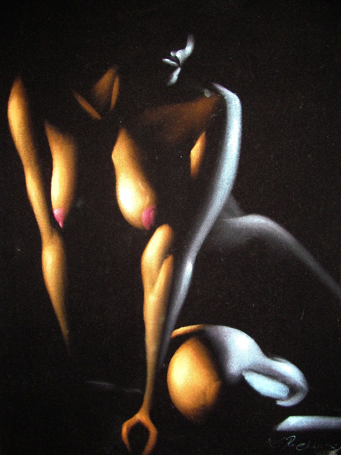 nude black girl with an afro drawing