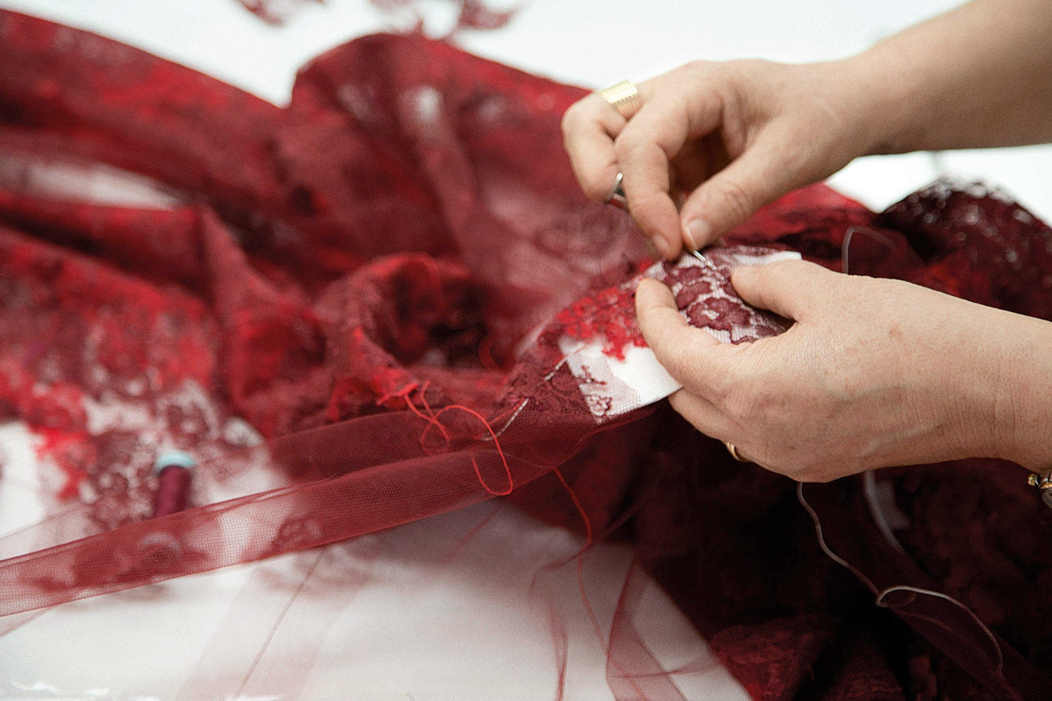 #Valentino show exclusive for #Shanghai boutique in november 2013 for 2014.  Making of red lace dress.  Funnily, I often use the same white paper background tip when I restore lace.