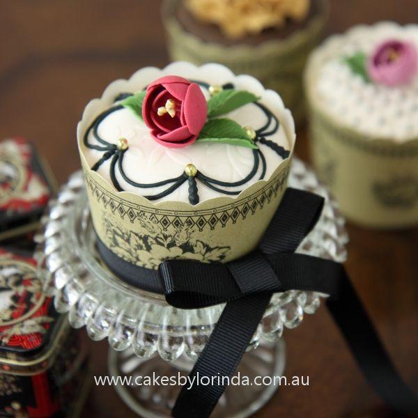 Burgundy Rosebud with Black Piping Cupcake