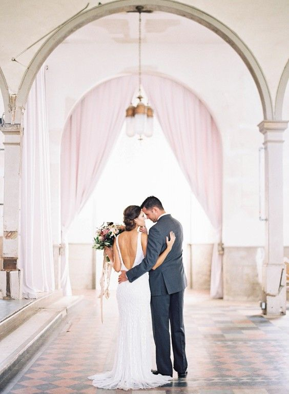 Marigny Opera House is a romantic  and historic New Orleans venue space. Tall ceilings and beautiful arched windows.  Photographer: Marissa Lambert Floral Design: Kim Starr Wise Event Design: Audra O'Dom