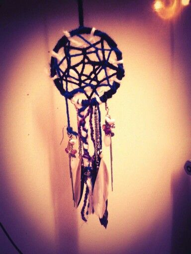 Handmade Dreamcatcher out of old jewelery and wool!  Love this hanging over my bed. DIY