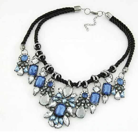 NOW AVAILABLE! BLUE AND BLACK STATEMENT NECKLACE So much more beautiful in real life! Blue and white crystals on a black necklace Jewelry Necklaces