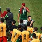 Francisco Javier Rodriguez, Carlos Salcido, Oribe Peralta and Rafael Marquez of Mexico take on fluids during a cooling break