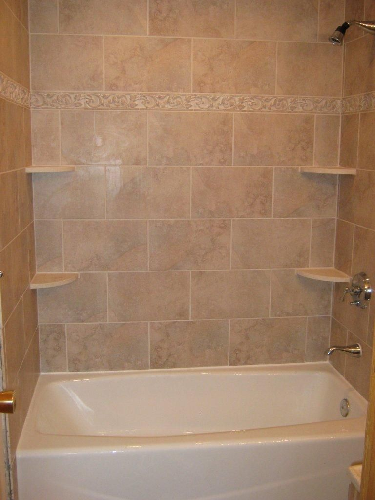 Bathtub walls or do we rip out the tub and shelving unit and it all becomes a larger shower Bathroom wall tiles laying designs