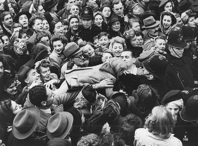 A London youngster is handed over the heads of spectators in Trafalgar Square, London, in an effort to prevent her from being crushed in the mass of people trying to witness the Royal Wedding procession of Princess Elizabeth and Lt. Philip Mountbatten, November 20th, 1947.