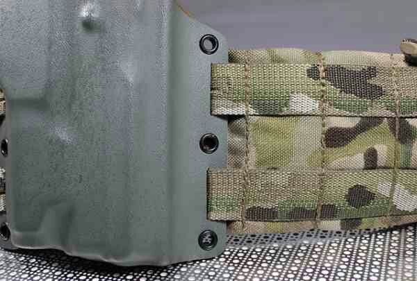 """Ares Armor's New MOLLE-Mounting """"Full Spectrum"""" Holster. Mounts without use of any hardware via slots cut into the Kydex itself ......... http://kitup.military.com/2014/05/ares-armors-molle-mounting-holster.html"""