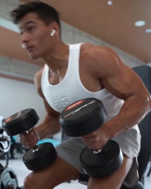 Armando training time! ????Try this: Rotating Dumbbell Press, Plate Raises, Lateral Raises & Rear Fl...