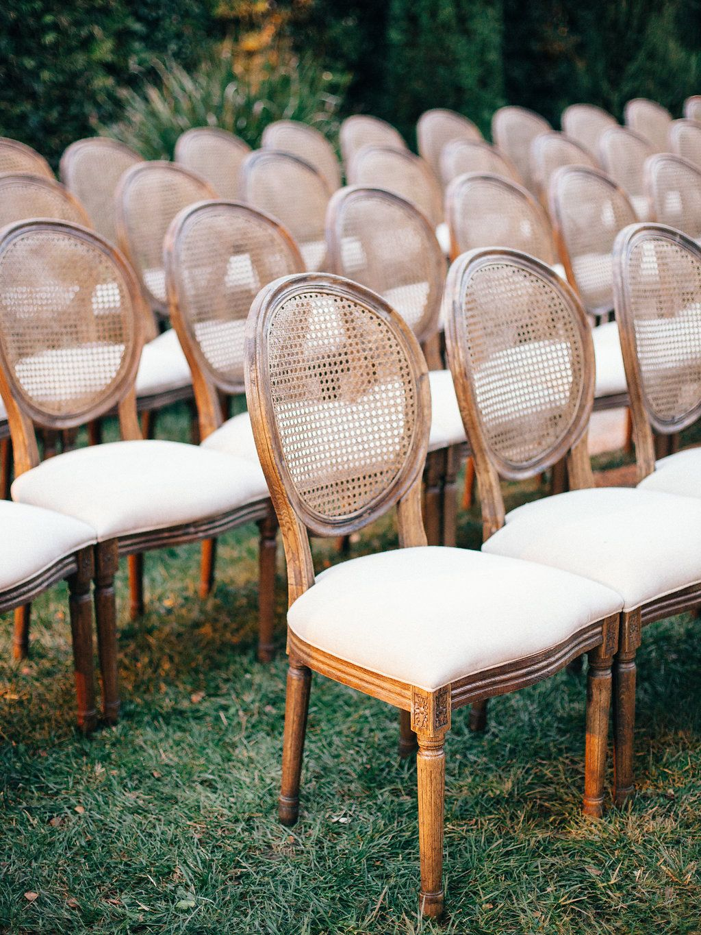 Cane back chairs white magnolia event design planning lovely chair wedding chair photo credit megan sorel