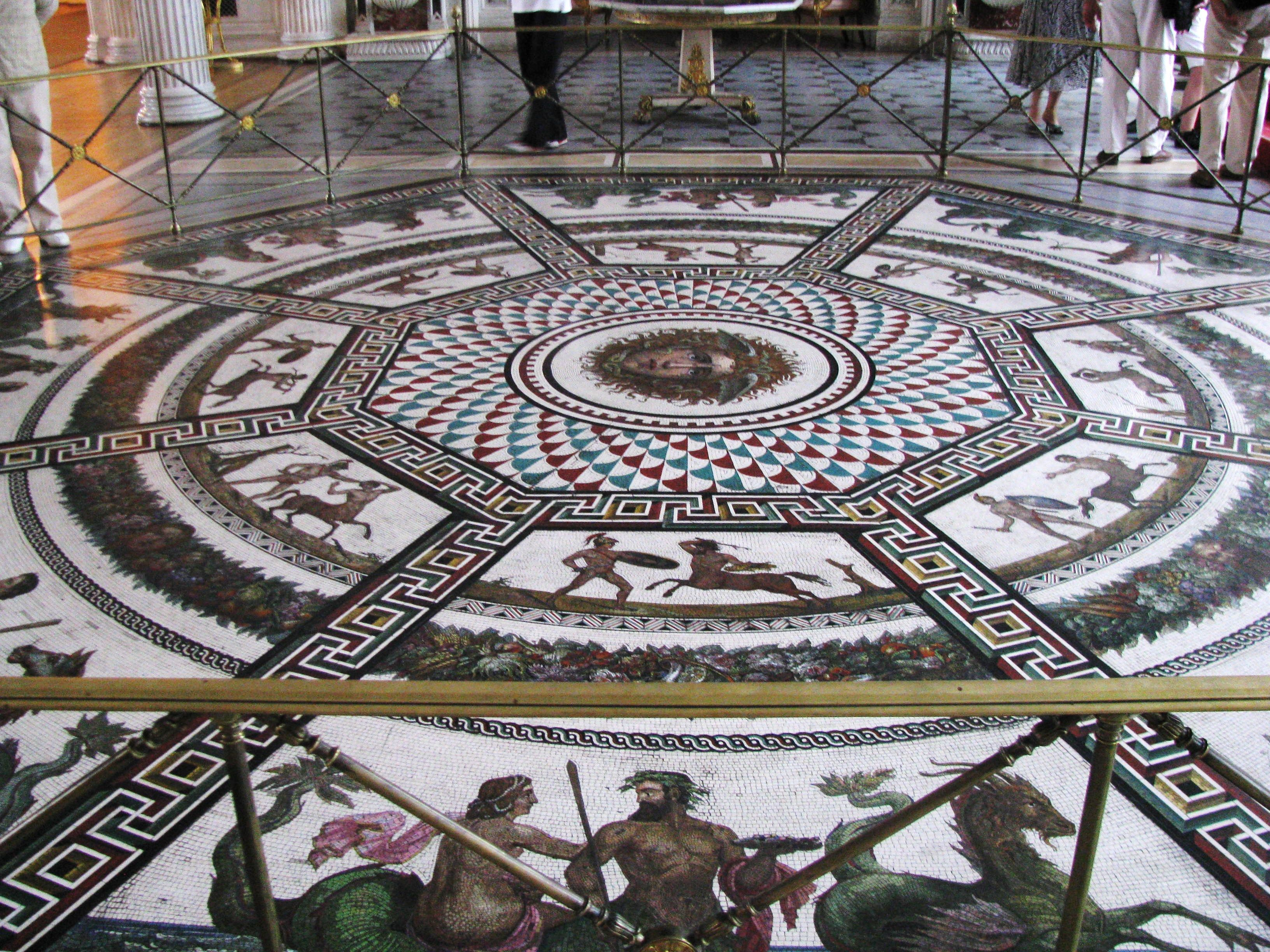 Gorgeous mosaic flooring. Love the attention to detail and storytelling.  Gives the space a