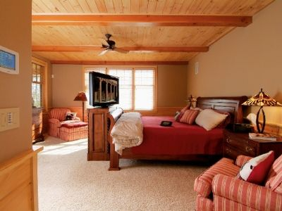 Master Bedroom With Flat Screen Television and Automatic Surround System