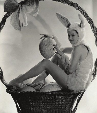 https://flic.kr/p/6e5auN | JS1263309 | ca. 1933 --- Actress Heather Angel poses as the Easter Bunny in a basket full of Easter eggs. --- Image by © John Springer Collection/CORBIS