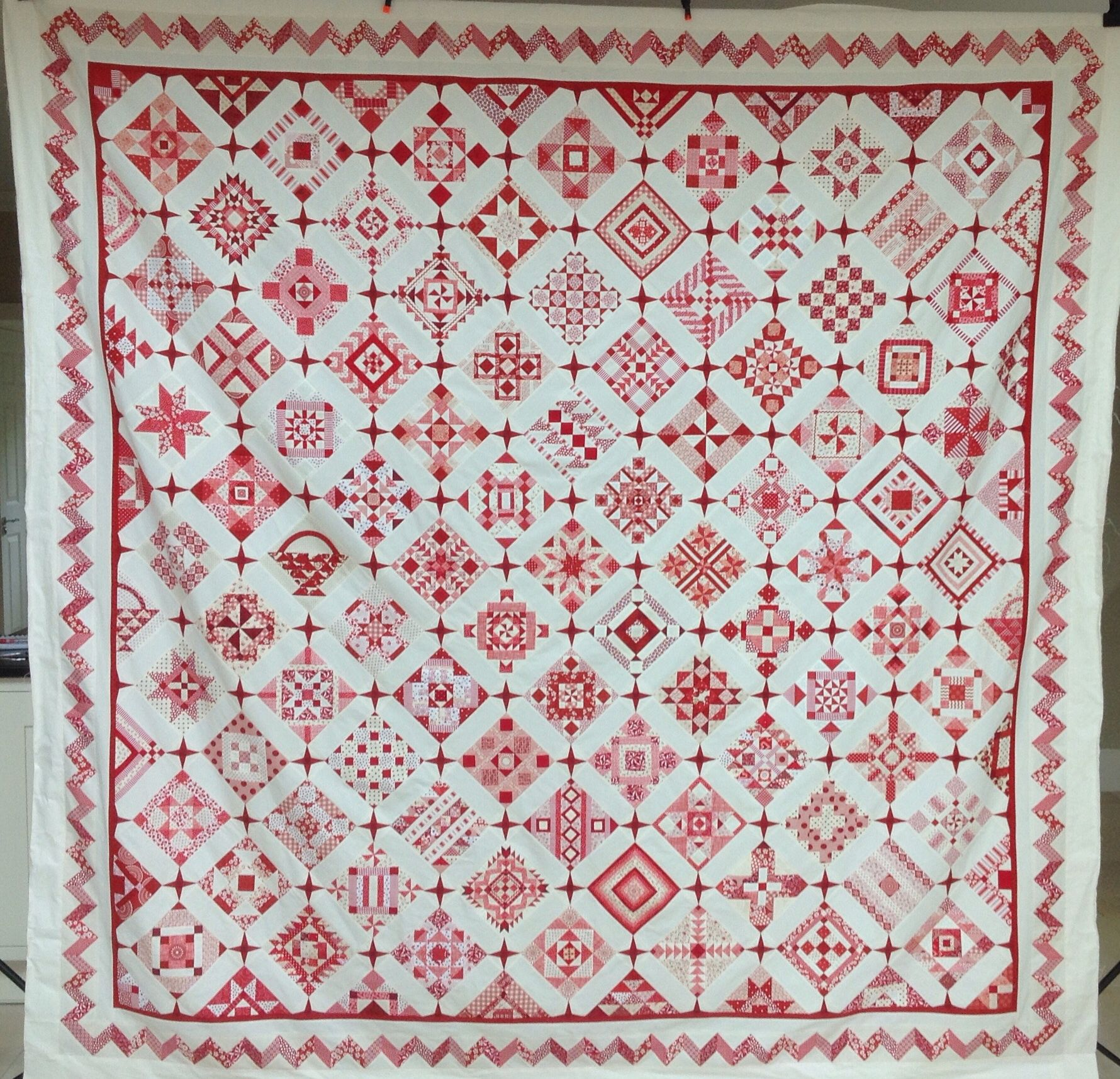 Nearly Insane quilt, salinda Rupp quilt. Red and White sampler quilt. Hand pieced english paper piecing.