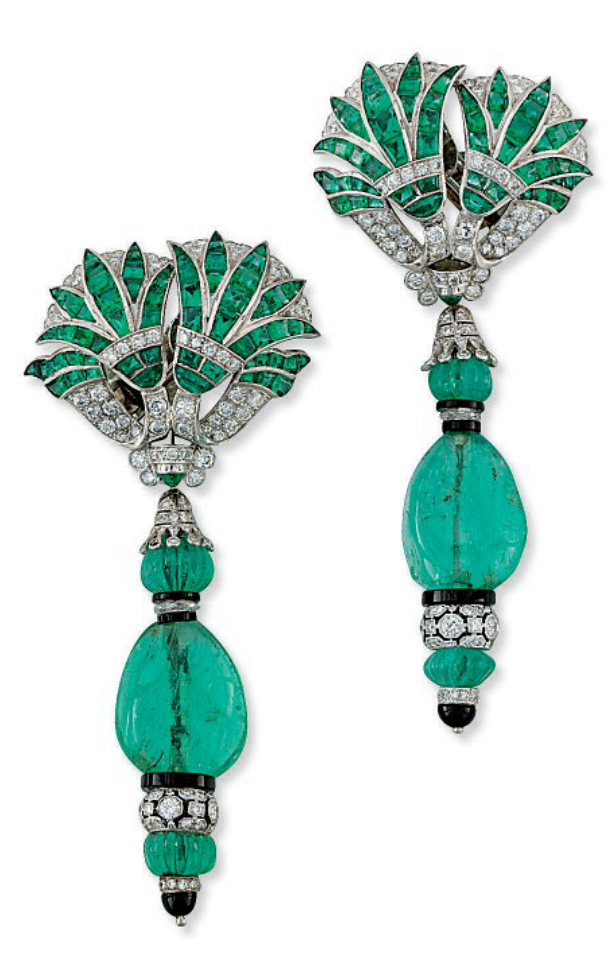 A PAIR OF EMERALD, DIAMOND AND ONYX EAR PENDANTS, BY FRED LEIGHTON.  Of modern manufacture in the 'Art Deco' style, each mounted with a detachable drop composed of an emerald bead with onyx, carved emerald, faceted diamond and diamond-set openwork rondelles to the pavé-set diamond and Calibré-cut emeralds of foliate design, 8cm long  One ear pendant signed FL for Fred Leighton