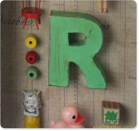Love this little shadowbox...a great way to put together some of the kid's small toys + vintage odds and ends I find.