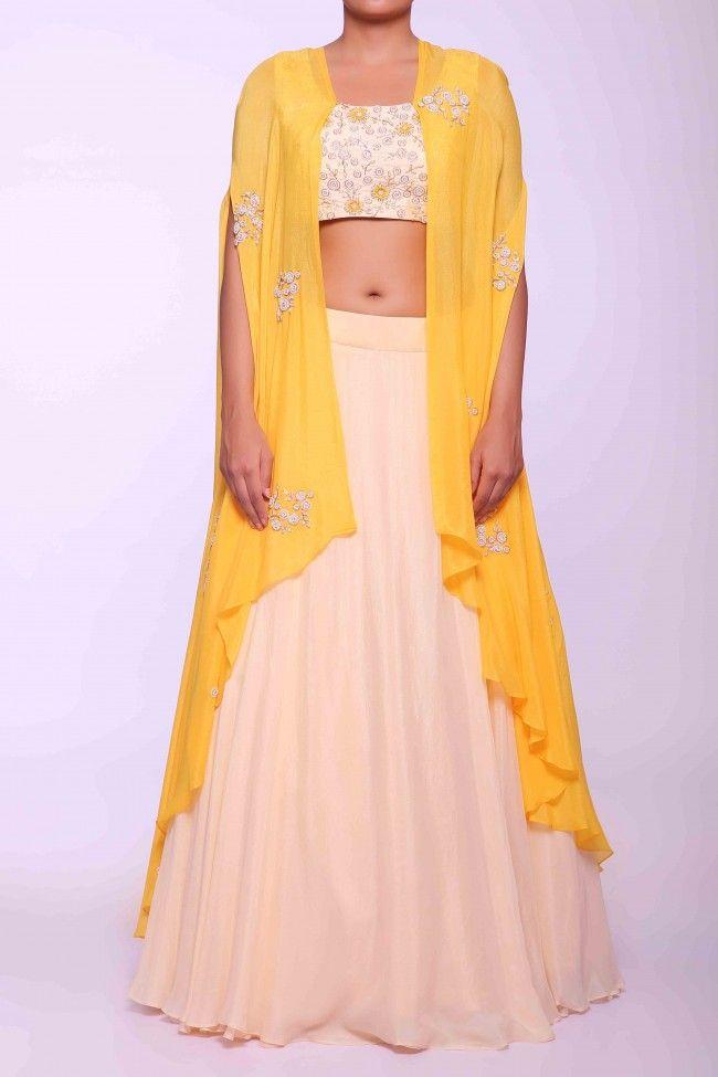 378b503e4d178 Sionnah Cream Lehenga Set With Yellow Shrug  blumuslin  multidesigner   online  onlineshopping  buynow  sionnah  shopnow  yellow  shrug  lehenga   indianwear ...