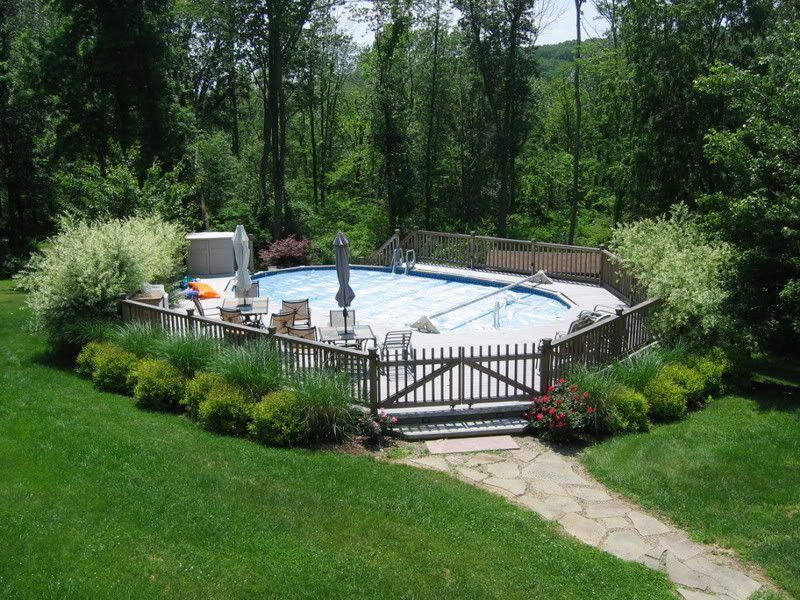 Landscaping around above ground pools thats an 18x33 ag for Pool deck landscaping