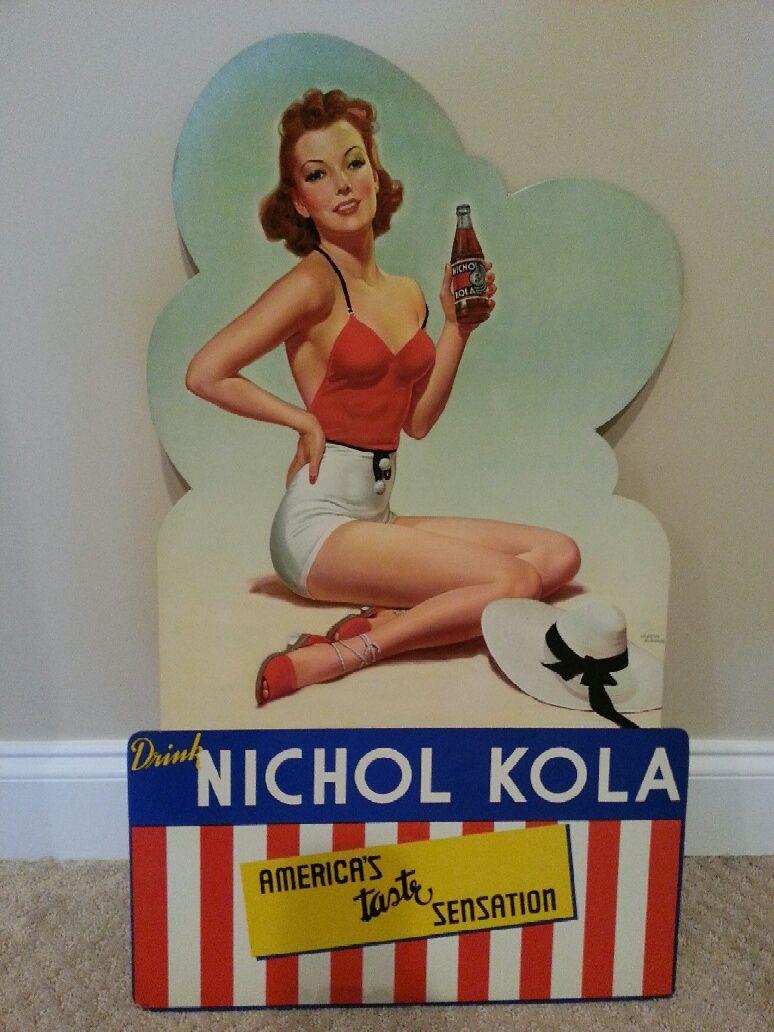 Nichol Kola cardboard sign