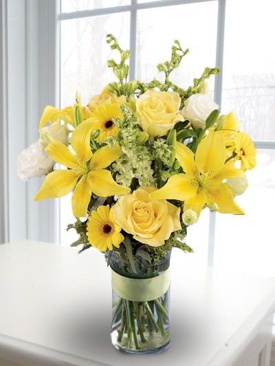 Yellow Lilies Gerbera Roses And Other Flowers In A Tall Vase