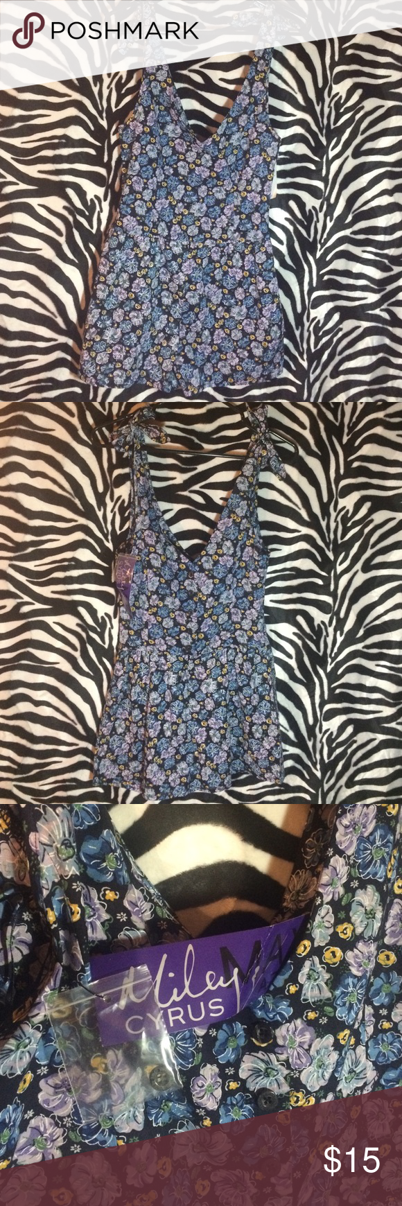Miley romper Super cute.. Floral print, shoulder ties are adjustable. NWT Miley cyrus Shorts