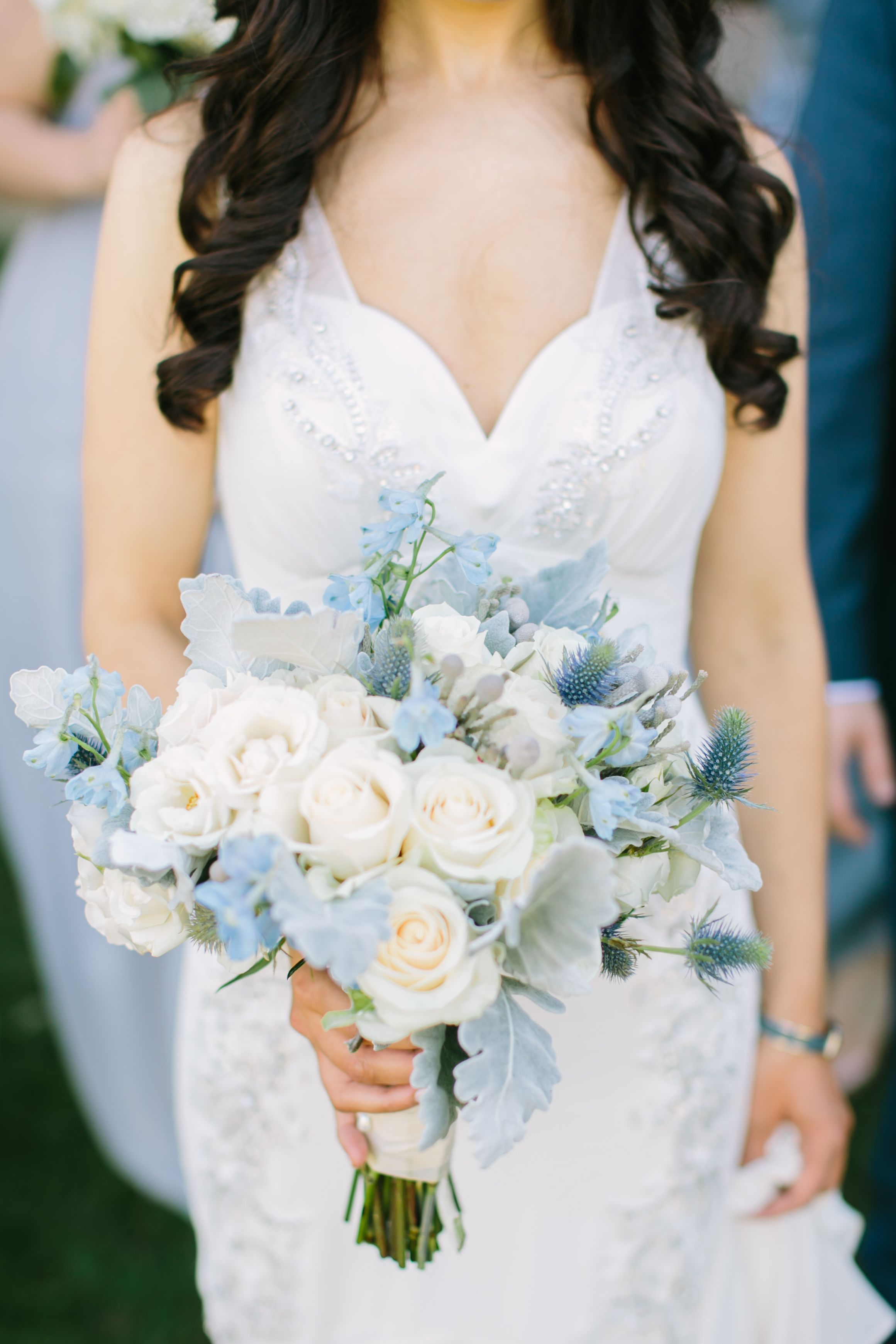 pale blue delphinium, thistle and dusty miller bouquet in