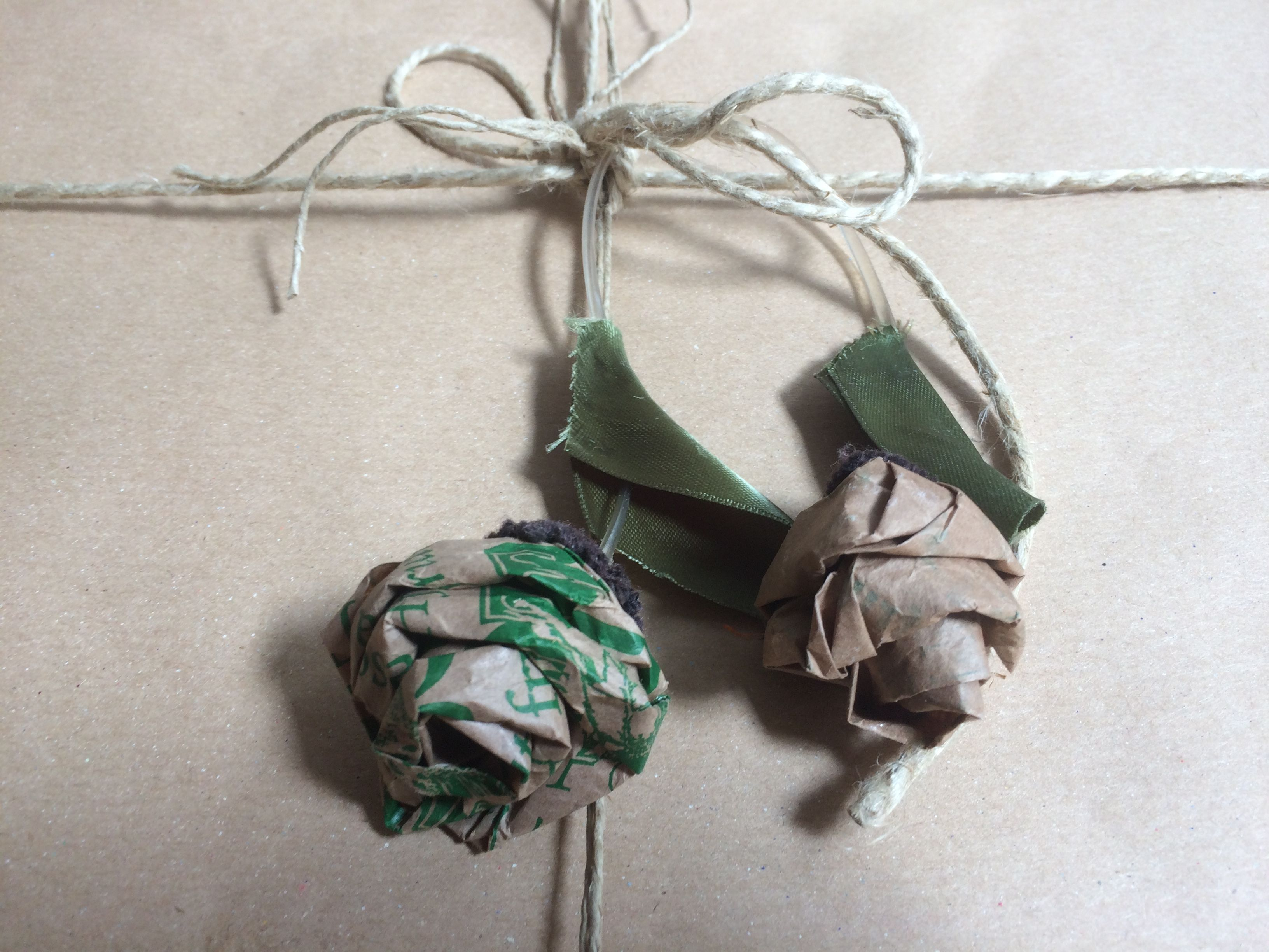 Wrapping idea for gift. Paper roses made with fruit bag.