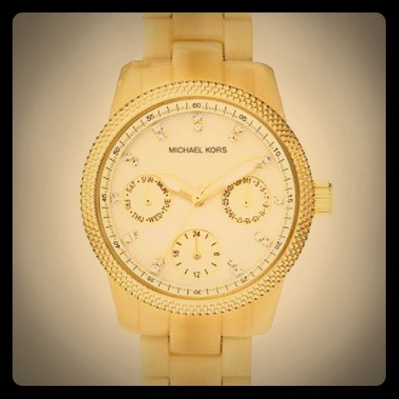 Michael Kors watch MK5400 Dazzle them with this bright watch by Michael Kors. Creme bracelet and round stainless steel case. Gold-tone bezel with crystal accents. White chronograph dial with gold-tone numerals and stick indices, logo, date window and three subdials. Quartz movement. Michael Kors Jewelry