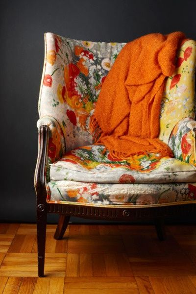 Floral Chair, Orange Throw Over Blanket.