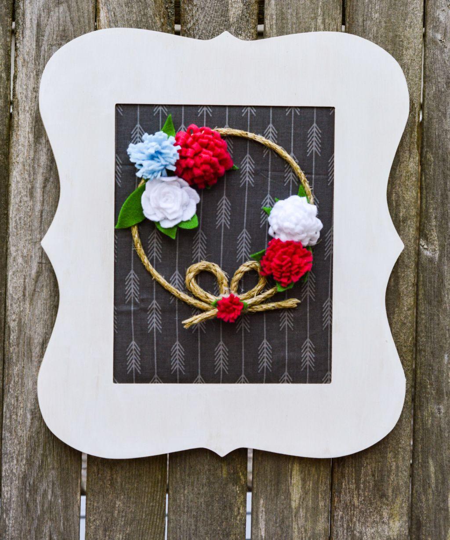Photo of Pretty front door wreath with simple felt flowers