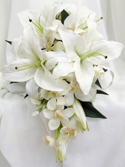 bridal white lilies with vanda orchids and sweetpeas