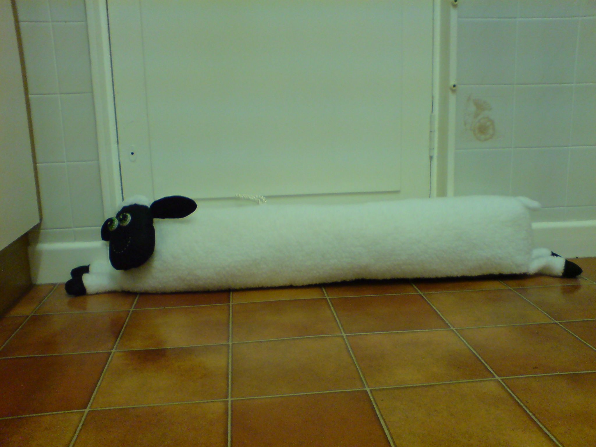 sheep draught excluder a made up pattern that can be adapted to