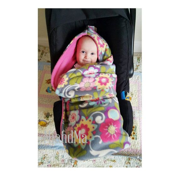 Limited edition!!  Is it difficult to keep you little one covered and warm in a car seat or stroller? This blanket solves all those problems and looks cute to boot! This soft cute multi functional swaddle blanket goes in the car seat or stroller and has openings for all the straps. Each blanket has a 3 and 5-point safety belt anchorages. Simply put blanket in the seat and baby goes on top. Fasten the straps and wrap baby snugly for a warm trip without worrying about the blanket slipping off…