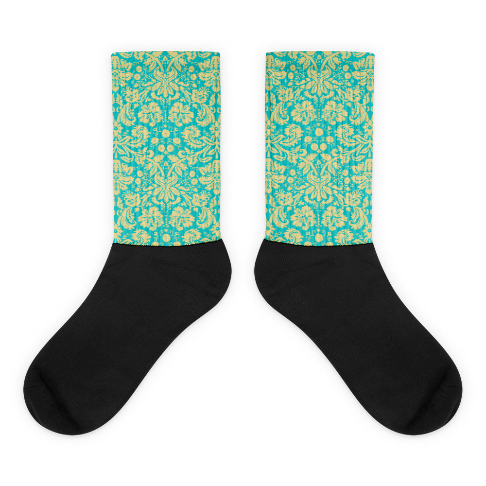 Fleur Black foot socks. These socks will give you maximum comfort and style simultaneously! The top of the sock is printed, the bottom portion is solid black, and each sock is printed individually in the USA.  • Thick ribbing, which provides a secure fit • Cushioned for maximum comfort  • Bold, crisp colors that won't fade • 60% Nylon, 22% Cotton, 18% Spandex  • Cold wash with like colors and hang dry