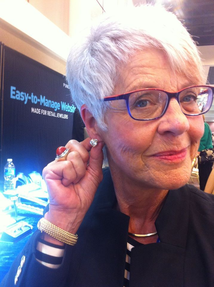 Mrs Ragnar Chris Trying On 5 Carat Diamond Studs At The Palm Springs Ijo Show