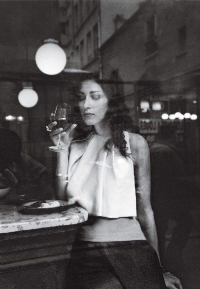 At Au Passage, a tapas and wine bar in the 11eme. The model is wearing Dior. (Condé Nast Traveler)