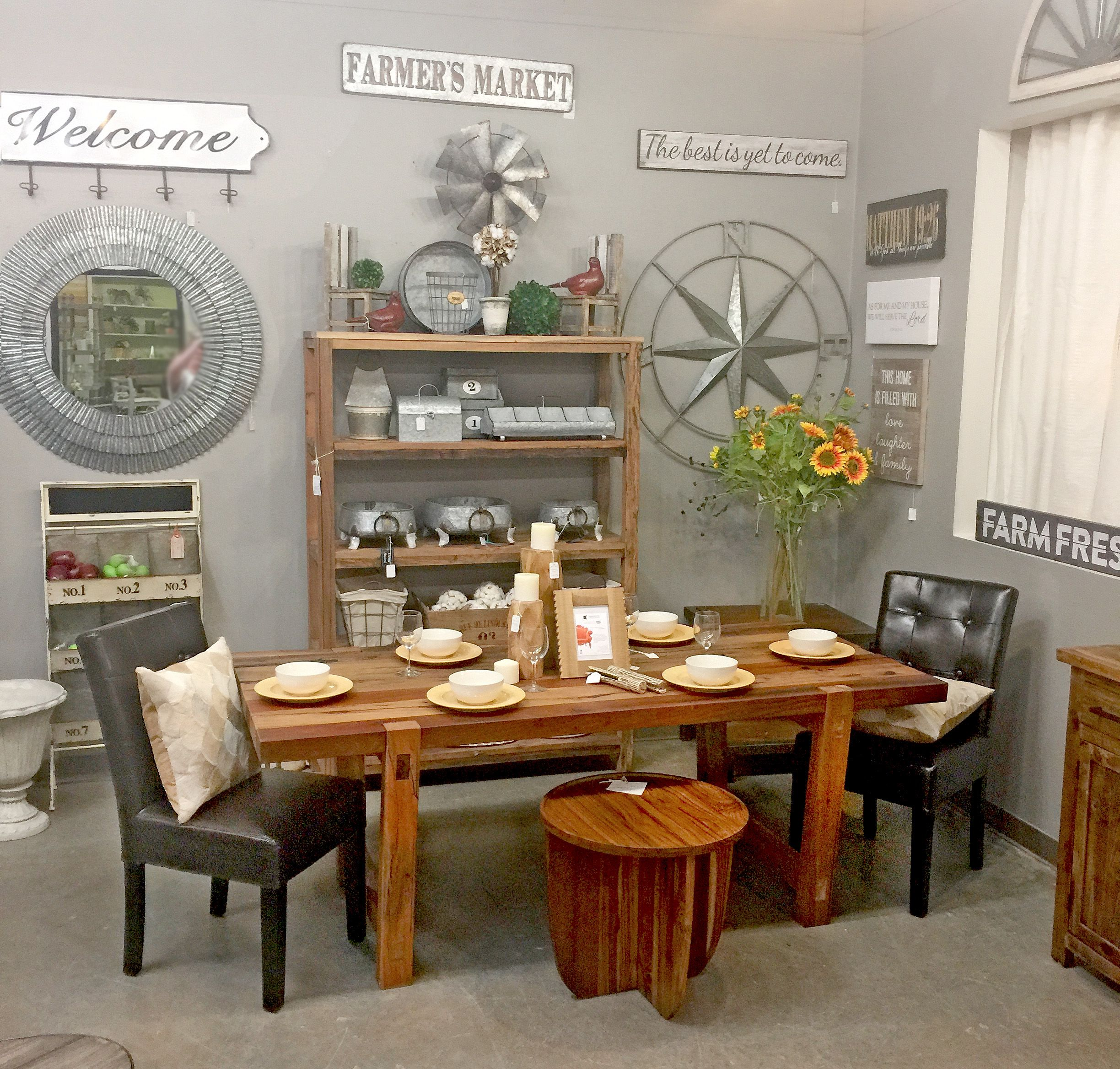 Industrial wood table mixed with leather tufted chairs and hints of