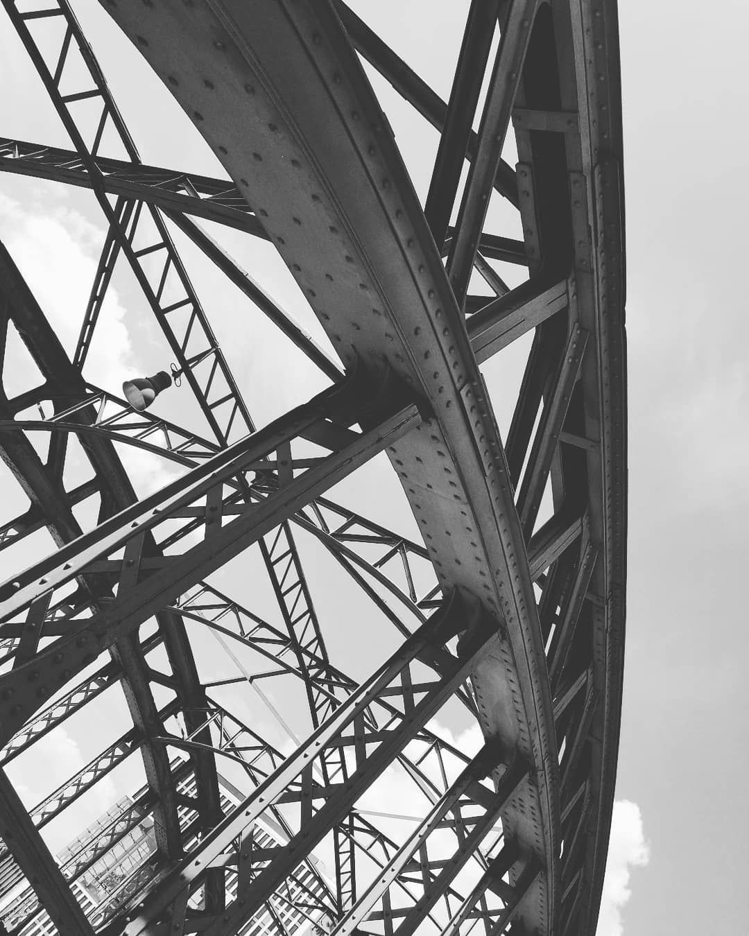 discovering the district  #strolling #munich #bridge #metalstuds #b&w #metalwork #metallic #industrial #architecture #oldfashioned #germany #metalstructure #strolling #framing #picoftheday #subjectivelyobjective #engineering