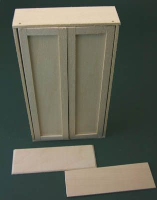 The base and top of a dolls house armoire are cut to overhang the side and front edges of the armoire case.