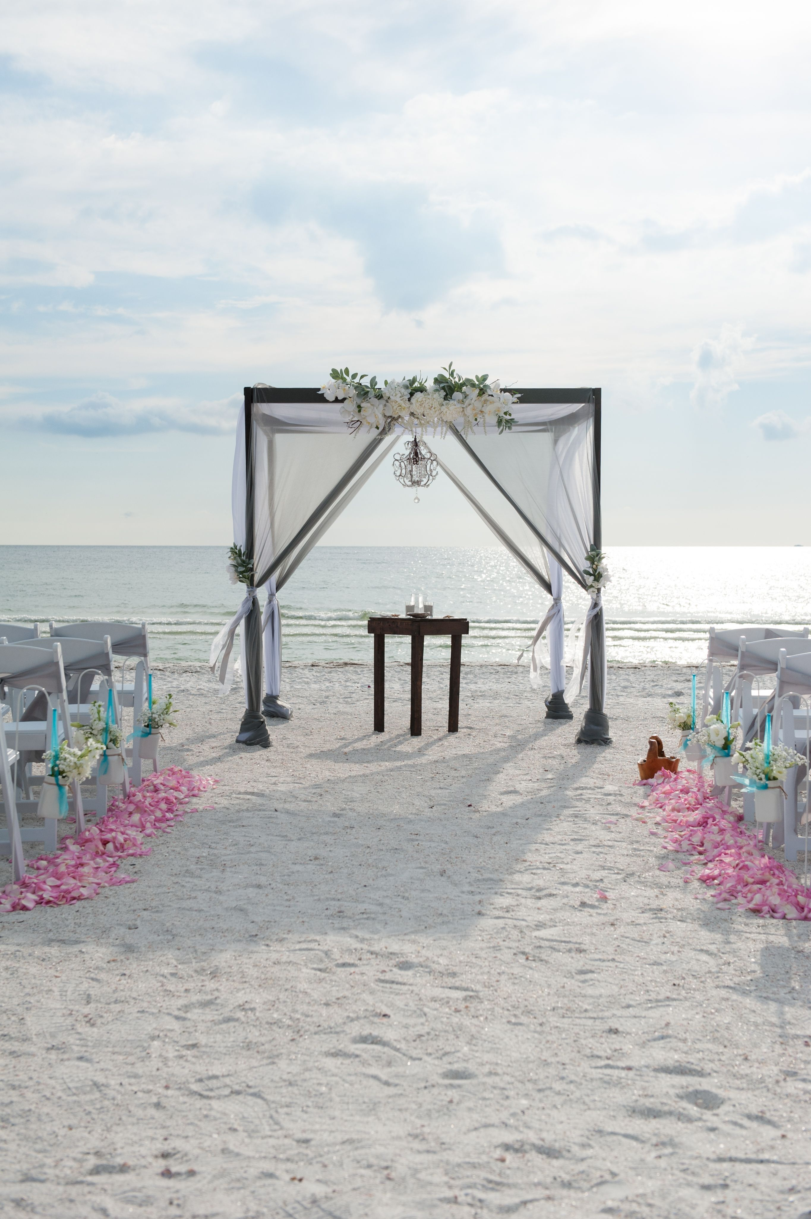 Gray and white wedding arbor with a pop of pink and turquoise ...