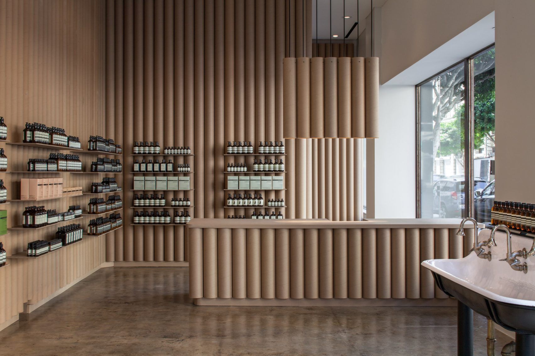 Brooks scarpa recycles cardboard tubes and paper for los angeles aesop store interior