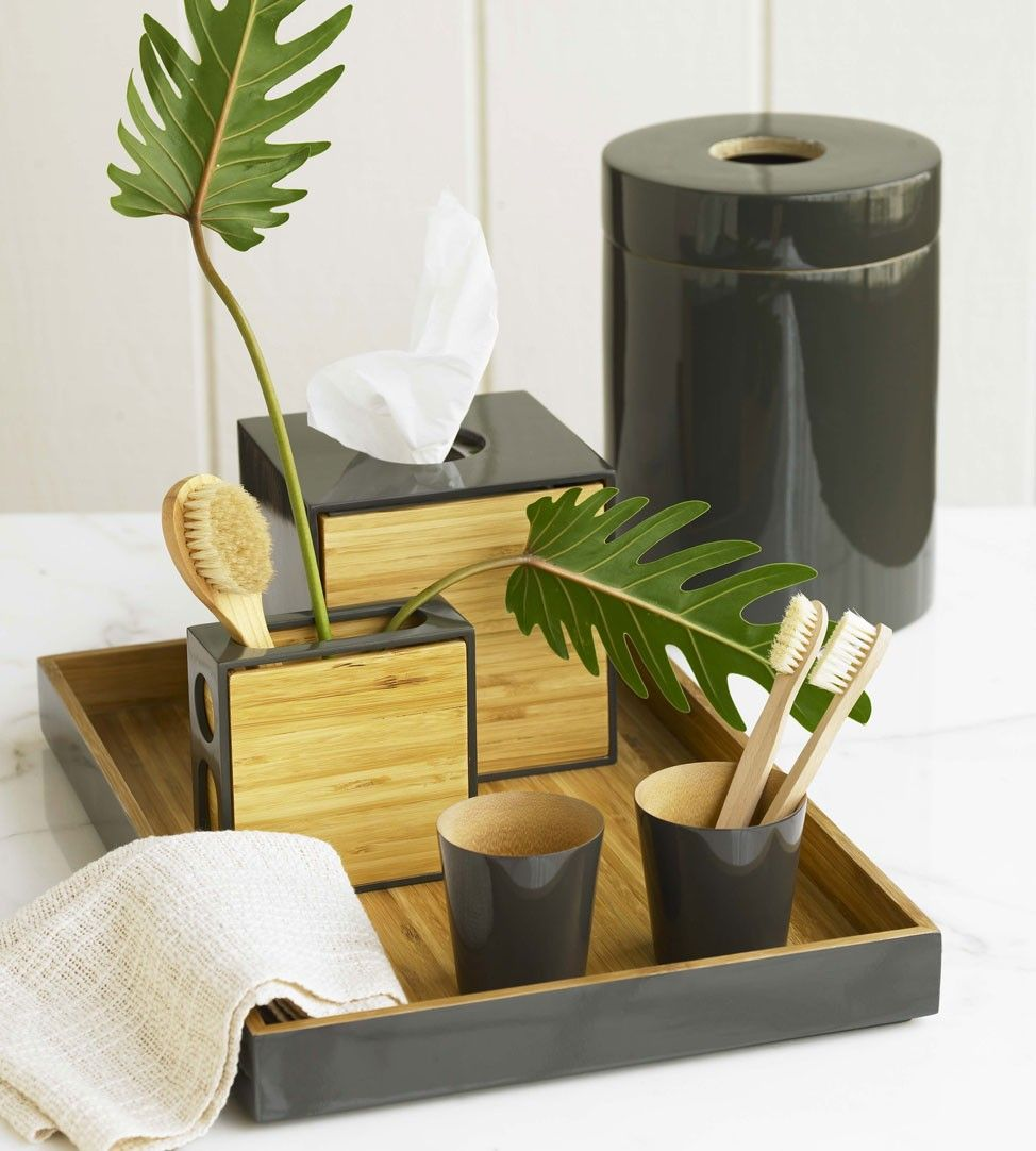 add some bamboo to your bathroom decor with something like this bathroom sink accessories bamboo bathroom accessories