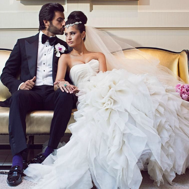 Dream bride Nadia, married her prince charming Sam in Beverly Hills, California, in a wedding fit for a princess. Nadia's exquisite fishtail figure hugging gown by bridal designer Rita Vinieris, featured a layered organza skirt and detailed embellished belt. Her diamond stud earrings and bracelets by Cartier, gifts from her husband-to-be, perfectly complimented her gown. Her hair was softly pulled back into a high updo and accessorized with an Erica Koesler jewelled headpiece. Her handsome…